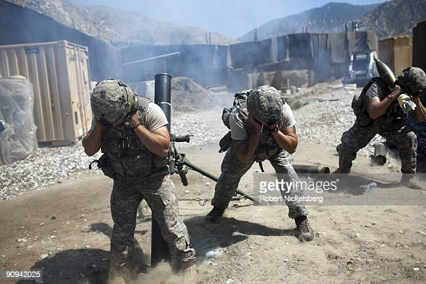 Army soldiers from 4th Infantry Division's 4th Brigade, 2 - 12 Infantry Regiment, Headquarters Company fire 120mm mortars at a taliban position that...