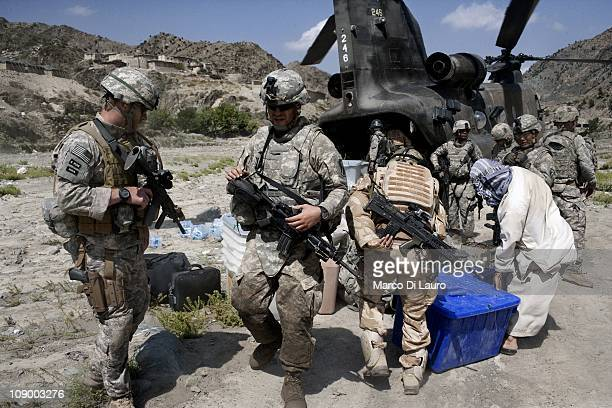Army soldiers from Alpha Company 1/121 Infantry 48th BCT carry ballots boxes back to their base by helicopter after the Presidential Elections after...