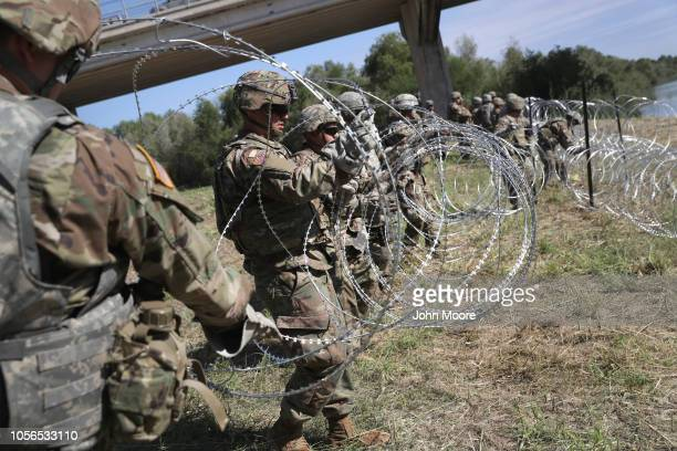 S Army soldiers from Ft Riley Kansas install protective wire along the Rio Grande at the USMexico border on November 2 2018 in Hidalgo Texas US...