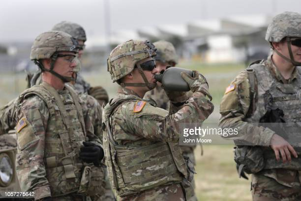 S Army soldiers from Ft Riley Kansas pause while stringing razor wire near the port of entry at the USMexico border on November 4 2018 in Donna Texas...