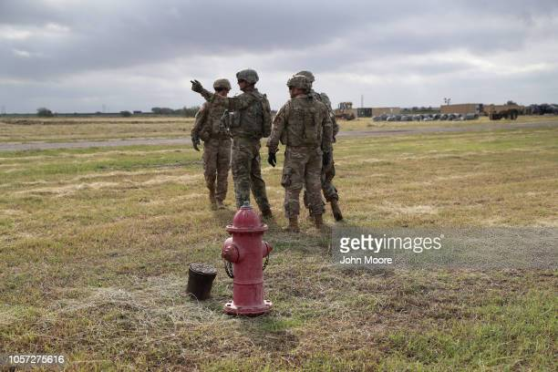S Army soldiers from Ft Riley Kansas prepare to string razor wire near the port of entry at the USMexico border on November 4 2018 in Donna Texas...