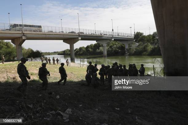 S Army soldiers from Ft Riley Kansas rest along the Rio Grande after installing protective wiring at the USMexico border on November 2 2018 in...