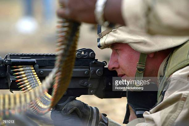 US army soldiers from the 101st Airborne Division fire a M249 light machine gun April 12 2002 at the Bagram Air Base firing range US troops are in...