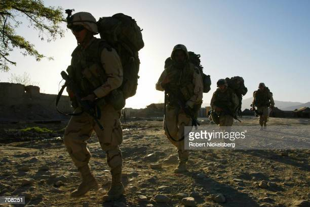 Army soldiers from the 101st Airborne Division head off on a early morning march April 10, 2002 at Bagram Air Base, Afghanistan. The 101st Airborne...