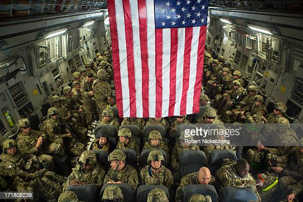 S Army soldiers from the 101st Airborne Division wait to disembark a C17 cargo plane May 11 2013 at Bagram Air Base Afghanistan After flying from...