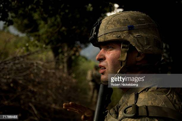 US Army soldiers from the 10th Mountain Division walk down a trail from a 7000 foot observation post in Kamdesh Nuristan August 25 eastern...