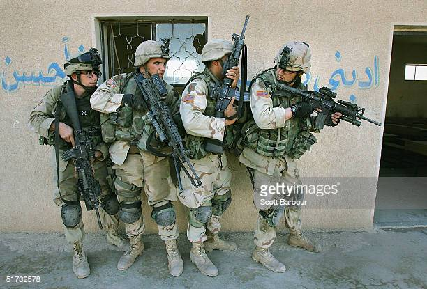 S Army soldiers from the 1st Infantry Division's 2nd Battalion2nd Regiment clear abandoned houses of insurgent fighters November 10 2004 during...