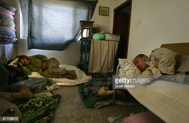 S Army soldiers from the 1st Infantry Division's 2nd Battalion2nd Regiment sleep in a captured Iraqi home November 10 2004 during a break in fighting...