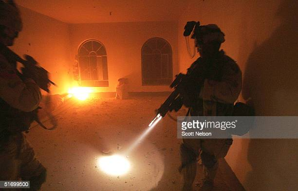 S Army soldiers from the 1st Infantry Division's 2nd Battalion2nd Regiment sweep through an abandoned home during heavy fighting November 9 2004 in...