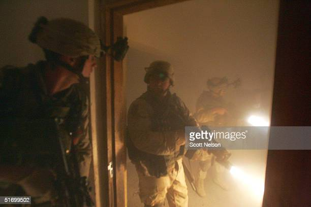 S Army soldiers from the 1st Infantry Division's 2nd Battalion2nd Regiment sweep through an abandoned and partially burning house during heavy...