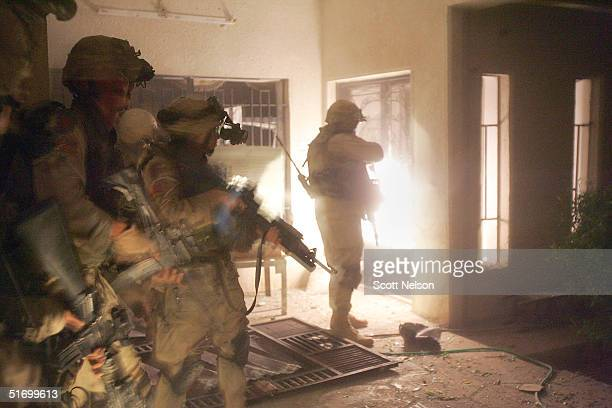 S Army soldiers from the 1st Infantry Division's 2nd Battalion2nd Regiment sweep through an abandoned house during heavy fighting November 9 2004 in...