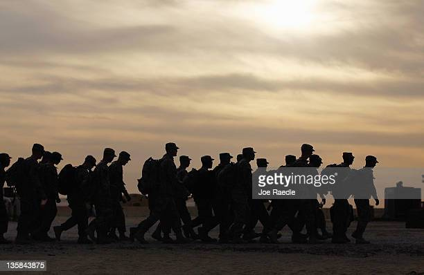 S Army soldiers from the 282 Field Artillery 3rd Brigade 1st Cavalry Division walk to where they will board buses to fly home to Fort Hood Texas...