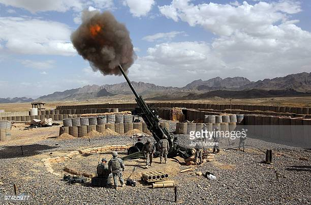S Army soldiers from the 317 Field Artillery fire a 155mm Howlitzer at a Taliban observation point on March 5 2010 from Forward Operating Base...