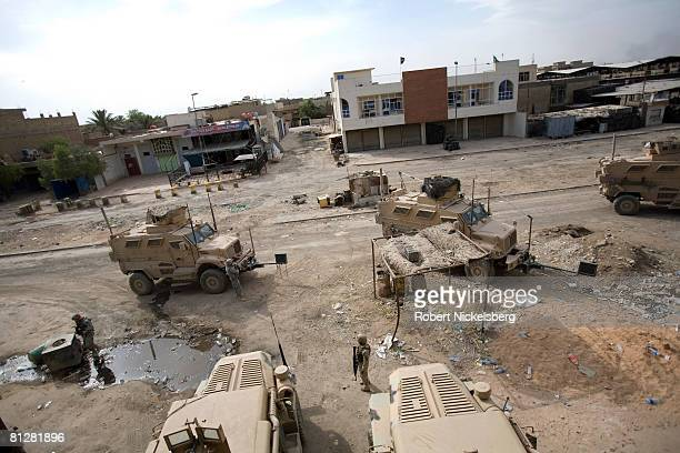 Army soldiers from the 3rd Brigade Combat Team 4th ID post security outside Jamila Market district of Sadr City in front of an Iraqi Army post in the...