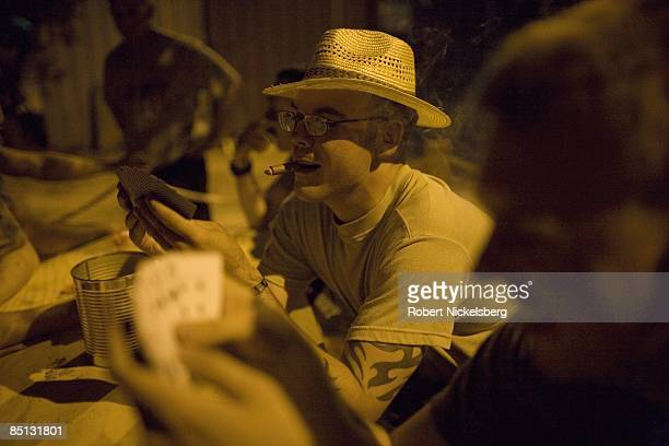 Army soldiers from the 3rd Brigade Combat Team 4th ID smoke cigars play dominoes and cards at the opening night of the Hammerhead Yacht Club...