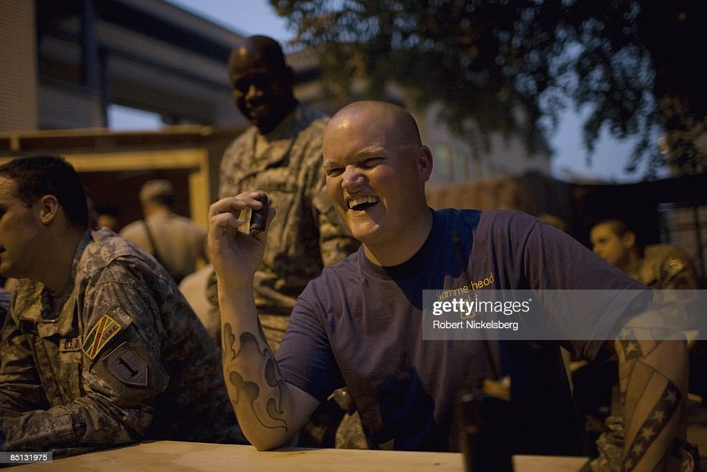 US Army Soldiers At The Hammerhead Yacht Club Cigar Night : News Photo