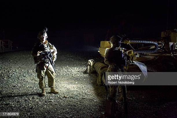 US Army soldiers from the 4th Brigade 3rd Infantry Division prepare to leave on an early morning mission with the Afghan National Army May 6 2013 at...