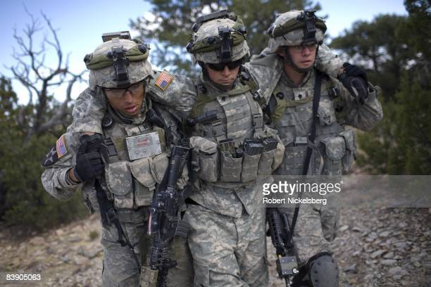 Army soldiers from the 4th Brigade Combat Team carry out a wounded soldier after coming under a simulated attack by Afghan Taliban insurgents during...