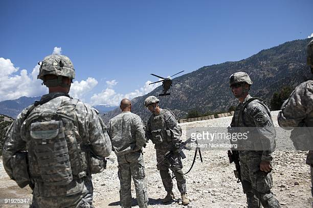Army soldiers from the 4th Infantry Division's 4th Brigade 2nd Battalion 12th Infantry Regiment based in Fort Carson Colorado gather at a landing pad...