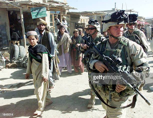 S Army soldiers from the 82nd Airborne Division secure an area during inspection of a local bazaar November 14 2002 in the town of Yayeh Kehl Paktia...