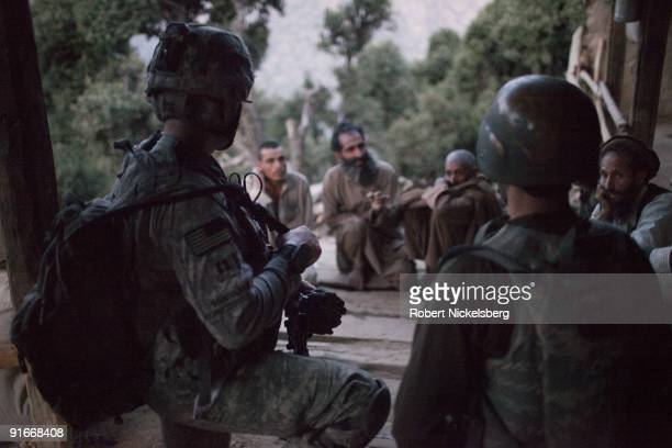 Army soldiers from US Army soldiers from 4th Infantry Division's 4th Brigade 2 12 Infantry Regiment Dagger Company question a family in the predawn...