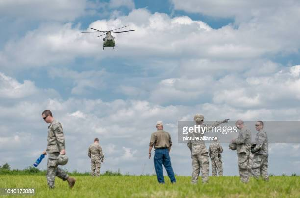 USArmy soldiers give hand signals to an approaching Boeing CH47 Chinook helicopter in Plankenfels Germany 18 May 2015 The pilots of a Sikorsky UH60...