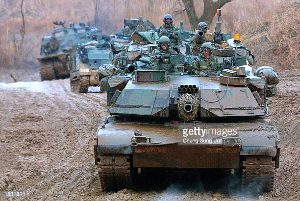 S Army soldiers in a row of M1 tanks and other military vehicles arrive for training in preparation for any possible surprise attack by North Korea...