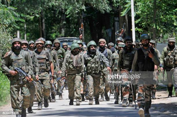 Army soldiers leaving the encounter site in BrentiBatpora village in Dialgam area of the district Anantnag on July 1 2017 some 60 kilometers from...