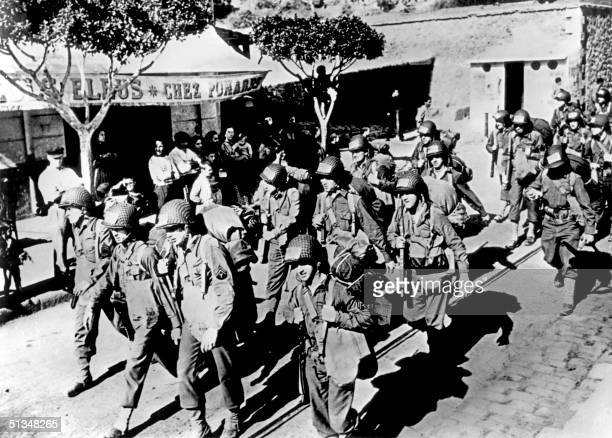 Army soldiers march in November 1942 through a section of Oran French Algeria after the greatest armada of ships and aircraft ever assembled for a...