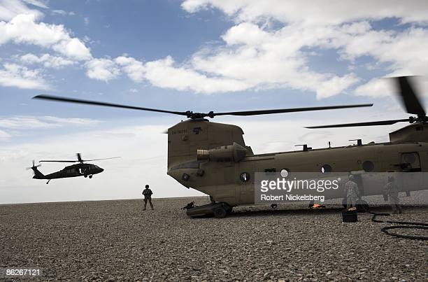 Army soldiers monitor the refueling of a US Army CH47 Chinook helicopter at a Forward Operating Base in Paktia province south central Afghanistan...