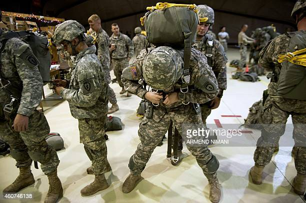 US Army soldiers of the 4th Infantry Brigade Combat Team 25th Infantry Division part of the NATOled peacekeeping mission in Kosovo prepare their gear...