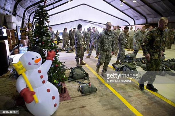 US Army soldiers of the 4th Infantry Brigade Combat Team 25th Infantry Division part of the NATOled peacekeeping mission in Kosovo walk past a...