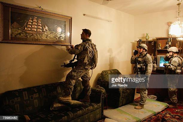 S Army soldiers of the DCO 2/325 AIR 82nd Airborne Division search a home during a raid April 26 2007 in Baghdad Iraq The homes were targeted after...