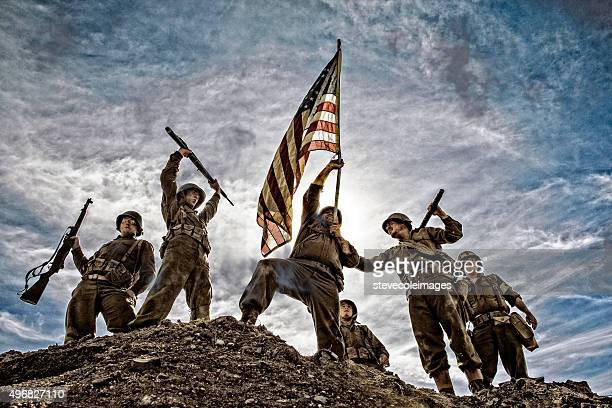 us army soldiers on hill with american flag - marines military stock photos and pictures