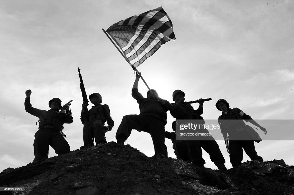US Army Soldiers on hill with American Flag : Stock Photo