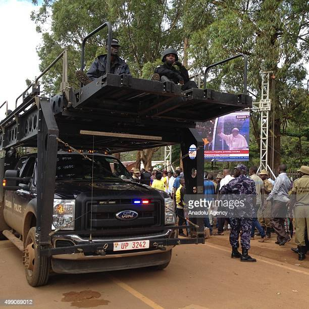 Army soldiers patrol the crowd waiting to enter to attend a Mass for the martyrs of Uganda celebrated by Pope Francis near the Catholic shrine of...
