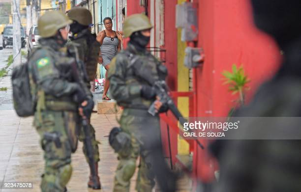 Army soldiers patrol the Vila Kennedy favela in Rio de Janeiro on February 23 2018 More than 3000 soldiers supported Rio de Janeiro police Friday in...