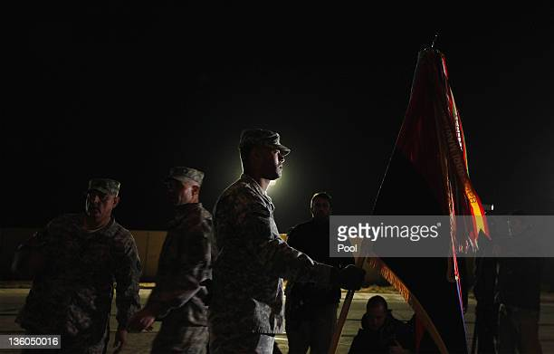 Army soldiers perform a casing of the colors ceremony signifying the departure of the 3rd Brigade Combat Team, 1st Cavalry Division as they depart in...