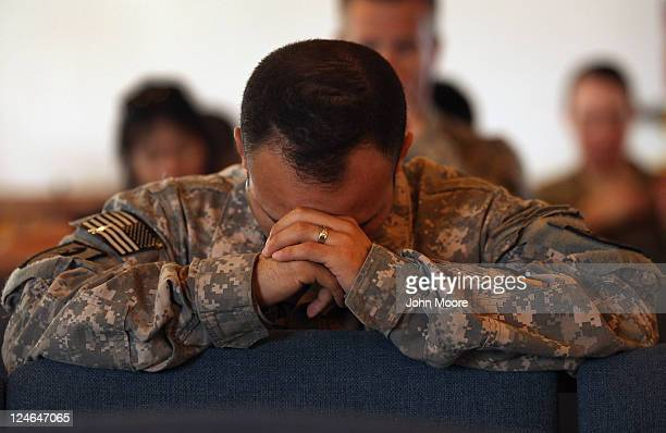 S Army soldiers pray during a Catholic service for the anniversary of the September 11 2001 terrorist attacks on September 11 2011 at Bagram Air...