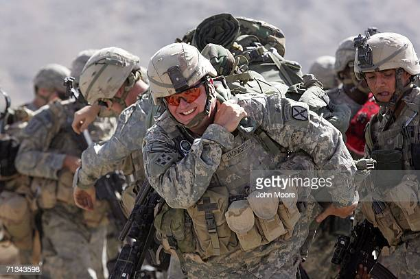 Army soldiers prepare to leave an American base at Deh Afghan on June 30, 2006 in the Zabul province of southern Afghanistan. Some 10,000 American...