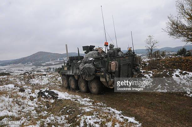U.S. Army soldiers pull security in a Stryker armored vehicle.