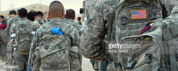 US army soldiers queue to board a plane to begin their journey home out of Iraq from the alAsad Air Base west the capital Baghdad on November 1 2011...
