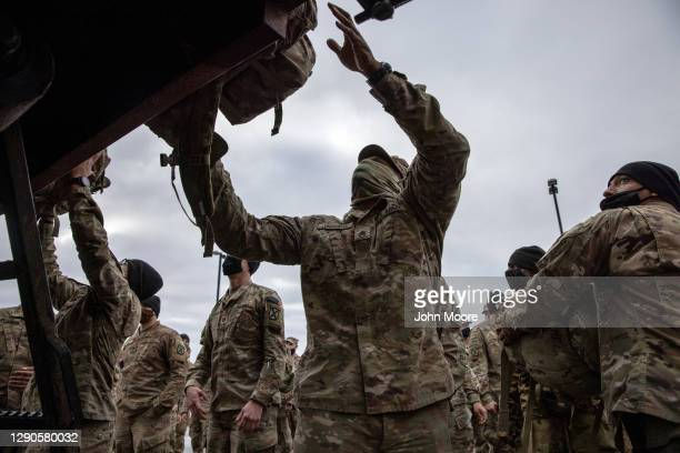 Army soldiers retrieve their duffel bags after they returned home from a 9-month deployment to Afghanistan on December 10, 2020 at Fort Drum, New...