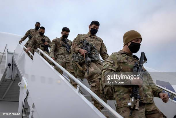Army soldiers return home from a 9-month deployment to Afghanistan on December 10, 2020 at Fort Drum, New York. The 10th Mountain Division soldiers...