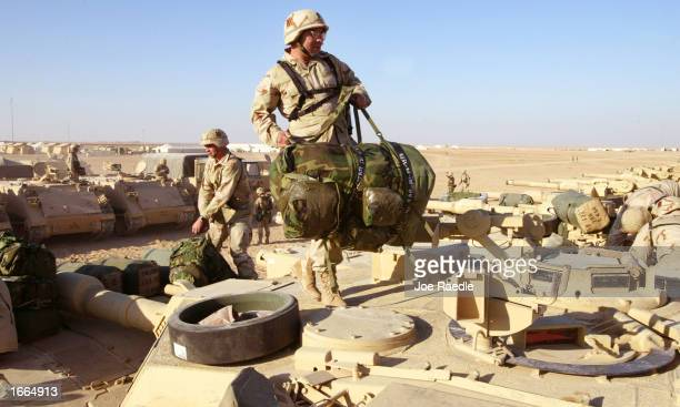 S Army soldiers return to base from an exercise with their A2 Abram tanks from the 464 armor regiment November 28 2002 at Camp New York Kuwait They...