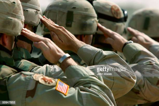 S Army soldiers salute during a memorial service for Sgt Robert Tucker at a military base October 18 2005 in Dujail Iraq Tucker from Cookeville...