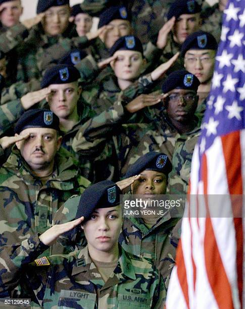US army soldiers salute during a welcoming ceremoney at a US Army Base in Daegu southeast of Seoul 04 February 2005 SixtyEight US Army Soldiers from...