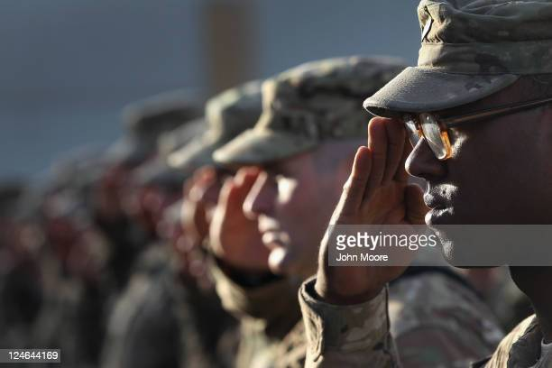 S Army soldiers salute during the national anthem during the an anniversary ceremony of the terrorist attacks on September 11 2001 on September 11...