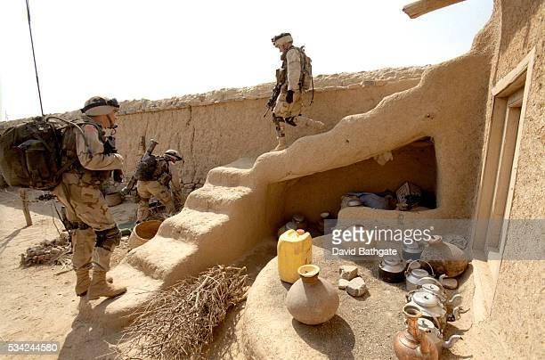US Army soldiers search a Pashtun home near the southern border with Pakistan