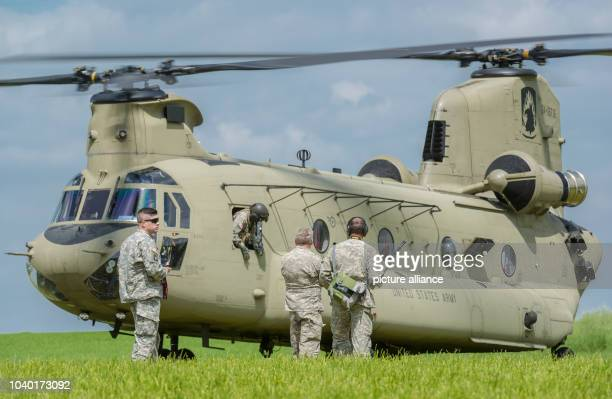USArmy soldiers stand in front of a Boeing CH47 Chinook helicopter in Plankenfels Germany 18 May 2015 The pilots of a Sikorsky UH60 Black Hawk...